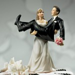 Holding the groom wedding cake Topper