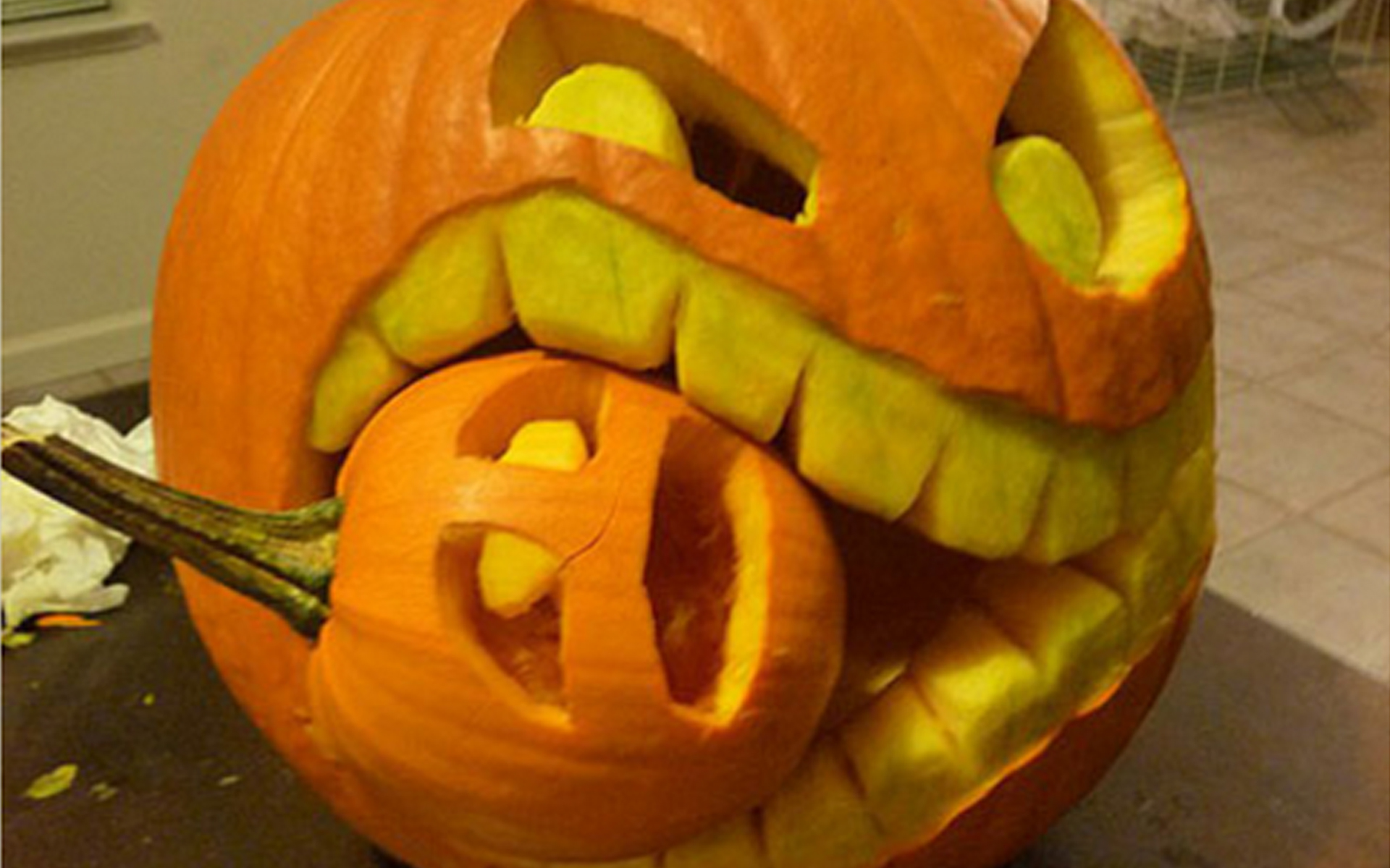 Halloween eating small pumpkin carving creative ads and Halloween pumpkin carving ideas