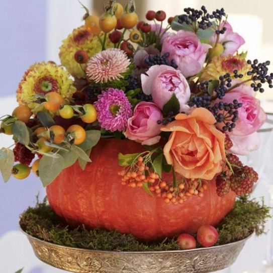 Thanksgiving Day Table centerpiece pumpkin and flowers