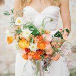Icelandic poppies, daffodils, ranunculus, camellias, jasmine, ferns, and ruscus wedding bouquet
