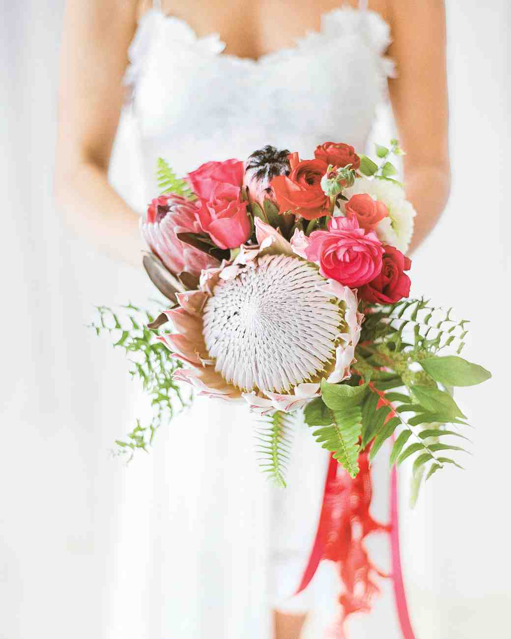 Krystal carried roses ranunculus ferns and one showstopping king krystal carried roses ranunculus ferns and one showstopping king protea wedding bouquet izmirmasajfo
