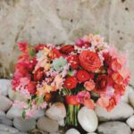bougainvillea, garden and tea roses, succulents, and coral creeper wedding bouquet