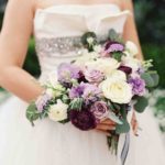 garden roses, lisianthus, scabiosa, ranunculus, and larkspur, with rosemary and eucalyptus wedding bouquet