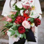 garden roses, smilax, ranunculus, festival bush, tulips, poppies, astilbe, peonies, and amaryllis wedding bouquet