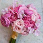 garden roses, standard roses, spray roses, ranunculus, and sweet peas wedding bouquet