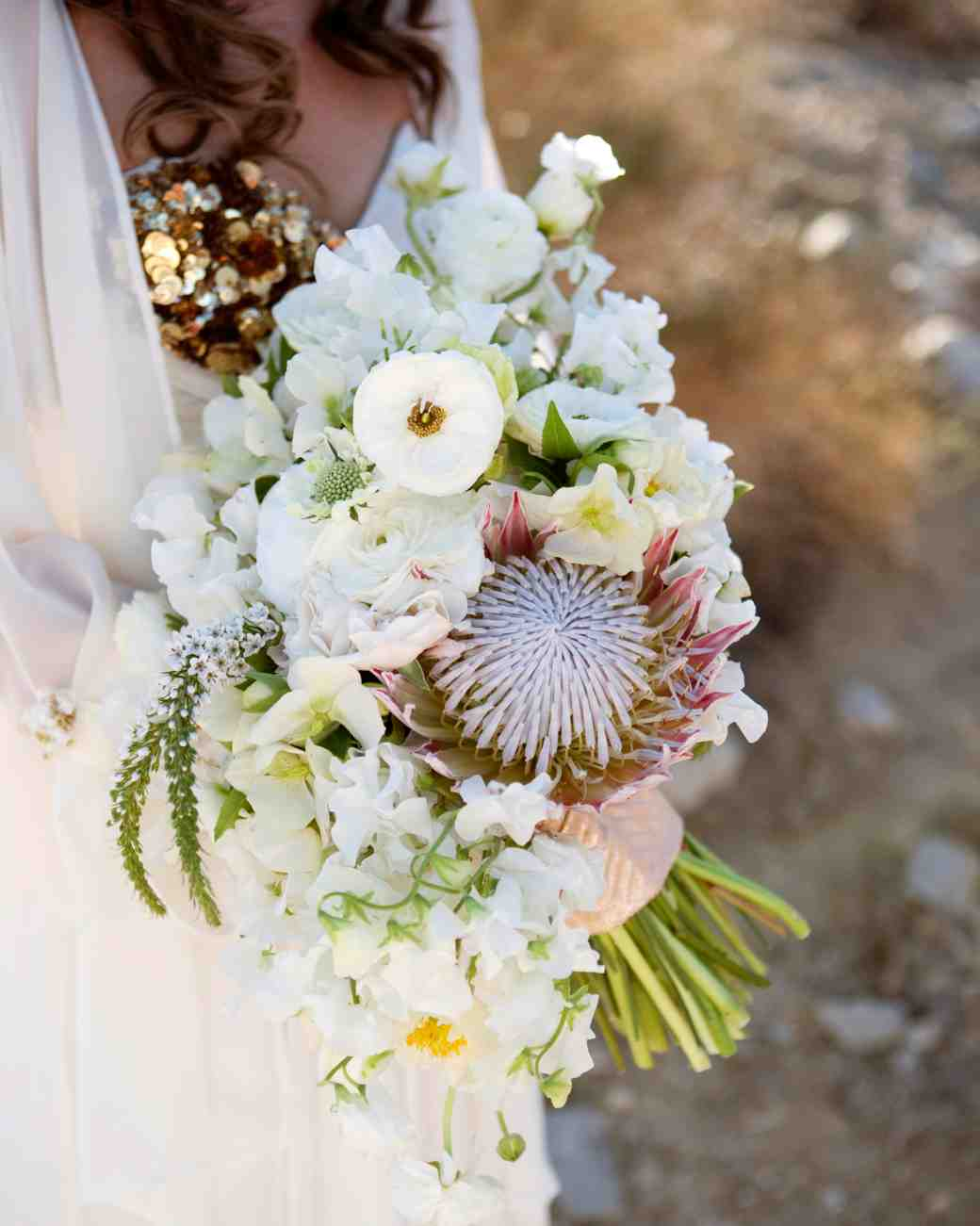 King Proteas Sweet Peas Ranunculus Veronicas Poppies And Garden Spray Roses Wedding Bouquet