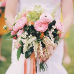 mix of roses, ranunculus, hellebores, and andromeda wedding bouquet