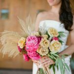 mixed peonies and heirloom garden roses with bay leaf and golden wild grasses wedding bouquet