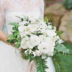 peonies, camellias, ranunculus, nerines, and crispa tulips wedding bouquet