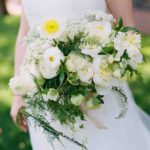 poppies, bleeding hearts, ranunculus, hellebores, peonies, Queen Anne's lace, and ferns wedding bouquet