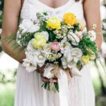 ranunculus, chamomile, and roses wedding bouquet