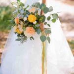 ranunculus, dahlias, roses, poppies, thistle, delphinium, and seeded eucalyptus wedding bouquet