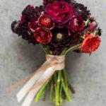 ranunculus, scabiosa, and dahlias wedding bouquet