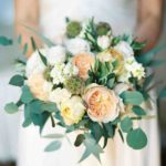 roses, peonies, ranunculus, and olive branches wedding bouquet