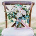 wild-looking bouquet - Quicksand roses, white majolica spray roses, scabiosa, viburnum berries, pieris japonica, calcynia, astilbe, geranium, veronica, bunny tail wedding bouquet